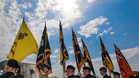 Flags held aloft by bearers during the playing of the last postPicture: STEPHEN WALLER /www.ste