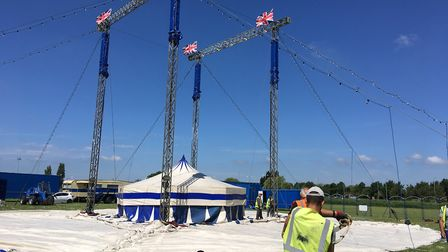 The huge Circus Fantasia big top rises from the ground on four king poles, secured by 128 steel stak