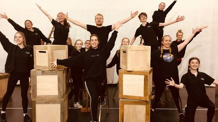 Some of the Co-op Juniors cast rehearsing for Barnum in the big top at Wherstead Park, Ipswich, from