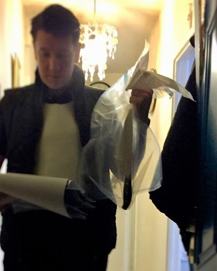 DS Pete Boyce with a knife found inside one of the addresses. Picture: METROPOLITAN POLICE