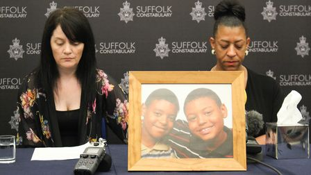 Relatives of the murdered teenager Tavis Spencer-Aitkens address a press conference, pictured l-r, s
