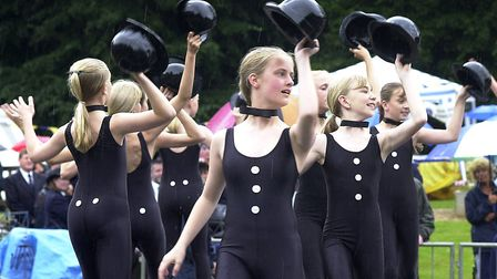 Co-op juniors singing in the rain at Ipswich Music Day in 2000 Picture: ANDREW HENDRY