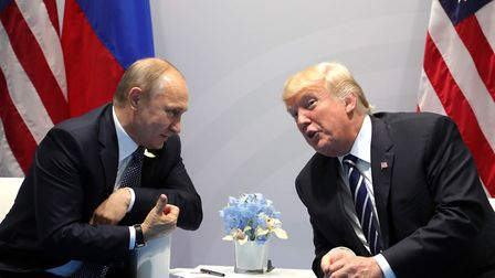 Vladimir Putin and Donald Trump at their meeting in Hamburg last year. Picture: PA