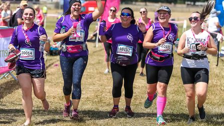 A group of friends cross the finish line in the Race for Life at Trinity Park Picture: STEPHEN WALLE