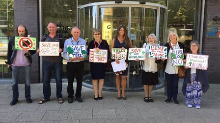 Demonstrators outside Ipswich Borough Council's planning meeting against the Mitre Way woodland deve