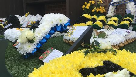 Floral tributes to Ipswich 17-year-old Tavis Spencer-Aitkens displayed at Michael Smy Funeral Direct