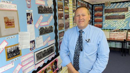 Former headteacher Ian Kearns looks at old pictures and memories on teh last day of Needham Market M