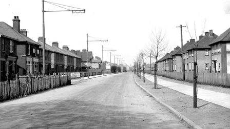 An empty Nacton Road, Ipswich, in the early 1930s. The Racecourse public house at the corner of Bena