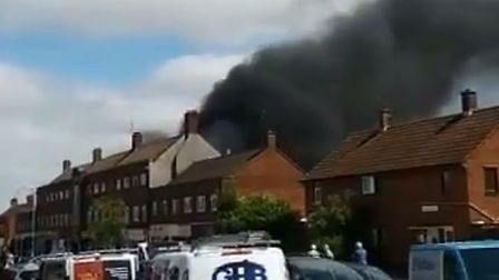 Thick black smoke can be seen pouring over homes Picture: @GECdcc via Twitter