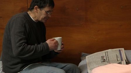 Enjoying a cup of tea and the newspaper at the Ipswich Winter Night Shelter. Picture: SIMON PARKER