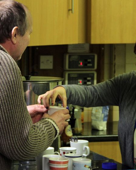 One of the homeless in Ipswich is served a cup of tea at the Ipswich Winter Night Shelter by one of