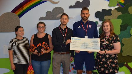 Richard Hibbert and Bart present a cheque for £4,463 staff at EACH Treehouse Picture: EACH