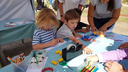Children in Holywells Park get involved in rocket making and planet spotting at Kinetic Science's ha