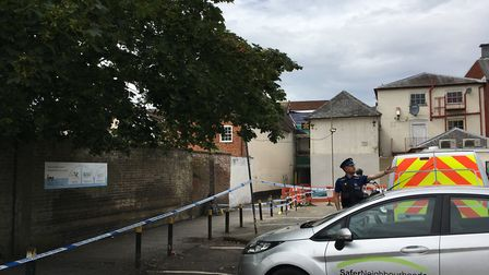 Police officers and PCSOs are still in attendance at the alleyway in Ipswich town centre . Picture: