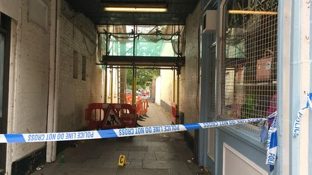 Evidence is marked on the floor of the alley and the investigation by Suffolk Constabulary continues