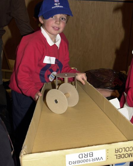 Henley Primary School pupil gathering junk to make fictitious characters Picture: KEITH MINDHAM