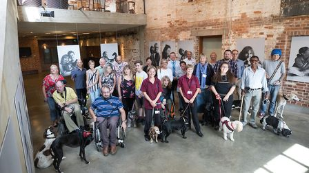 Dogs and owners helped by Sophie gathered at Snape Maltings Picture: BONCE PR