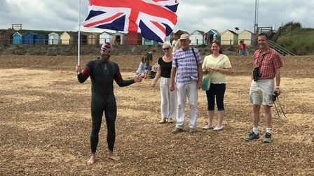 Richard arrives on the beach at Felixstowe after swimming from Sealand Picture: FACEBOOK RICHARD ROY
