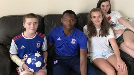 Ipswich Town player Tayo Edun paid a surprise visit to fan Adam Smith, 11. Adam and Tayo are picture