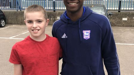 Ipswich Town player Tayo Edun paid a surprise visit to fan Adam Smith, 11. Picture: CHRISTINE SMITH