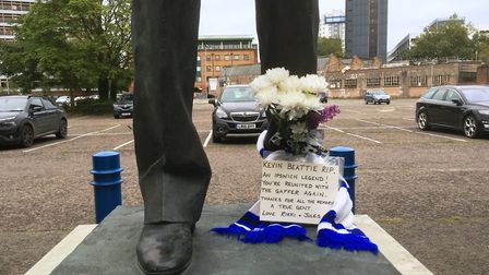 Town fans have placed flowers at the foot of the Sir Bobby Robson statue in Portman Road in memory