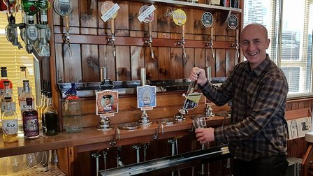 Briarbank Brewery homebrew competition 2017 winner John Watson pulling a pint of his Hobo's Gold in