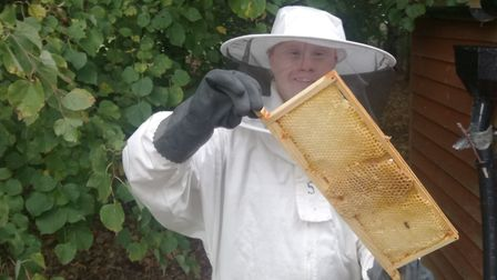 Volunteers working with bees at ActivLives community garden in Ipswich. The beekeeping project has