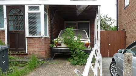 The house in Upton Close had been empty for many years and a tree had grown up in front of the car l