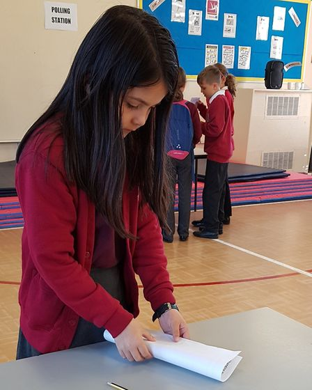 Pupils at Heath Primary School taking part in their own referendum and learning about voting by turn