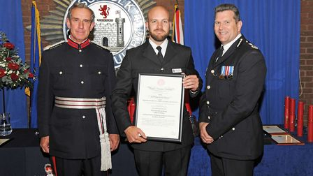 PC Jonathan Harvey receiving the Royal Human Society Award from MR Robert Rous (Her Majesty's Vice L