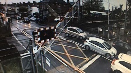 CCTV captures drivers on level crossing despite red warning lights blaring Picture: NETWORK RAIL