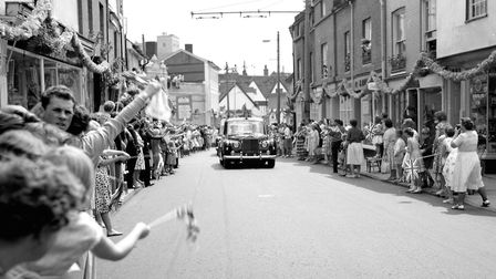 The Queen's car passing through crowds in Fore Street, Ipswich, in June 1961. Part of Fore Street Ba