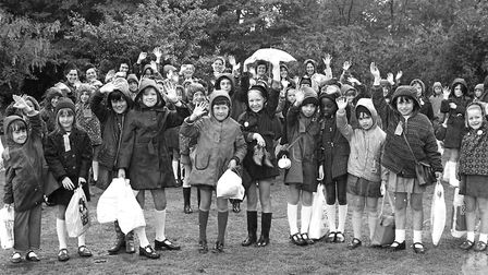 Summer rain did not stop this group of Guides and Brownies enjoying their day out in June 1974. Pict