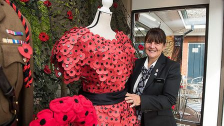 Funeral director Rita Peck with the display at the East of England Co-op Funeral Services branch in