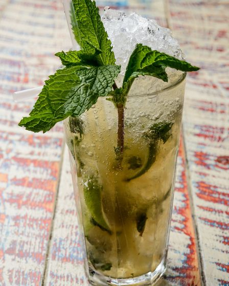 Mojito made with Ron Barcelo rum, muddled limes, fresh mint and crushed ice, lengthened with soda Pi