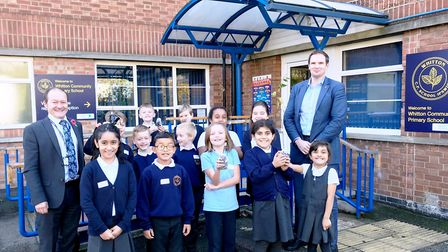 Dr Dan Poulter (right) with headteacher Stephen Capper and pupils at Whitton Primary with the trees