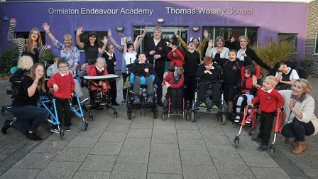 Children at staff at the Thomas Wolsey School celebrate the news that they have received an Outstand