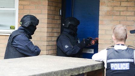 Police officers raid a house in Ipswich as part of a day of action targeting those suspected of supp