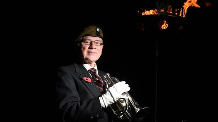 Phil Hubert playing the The Last Post Picture: SARAH LUCY BROWN