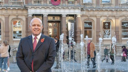 Ipswich Central's Terry Baxter in front of the new water feature on the Cornhill. Picture; NICOLE D