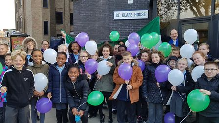 Children were given green and purple ballons to hold on teh Suffragette march. Picture: RACHEL EDGE