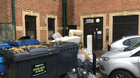 Sofas and discarded furniture can be seen against the Orchard House flats Picture: ARCHANT