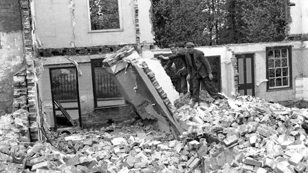Crash. Demolition workers show little concern for their own safety as they demolish houses close to