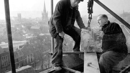 Workmen repairing the tower of St Margaret's Church, Ipswich, in October 1959, with little thought t