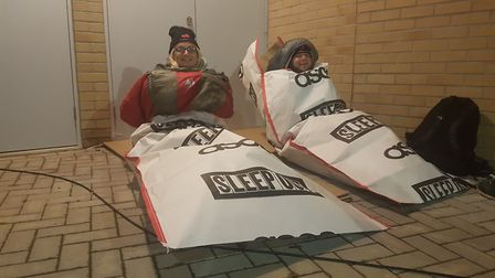 Attendees have wrapped up warm in sleeping bags and hats. Picture: WILL JEFFORD
