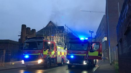 You can see the smoke behind the fire engines Picture: NEIL PERRY