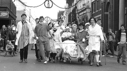 Pupils from Chantry High School doing a sponsored bed push through the town Picture: PAUL NIXON