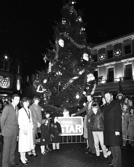 The Mayor of Ipswich posing with the Christmas Tree shortly after it was officially lit up in 1984