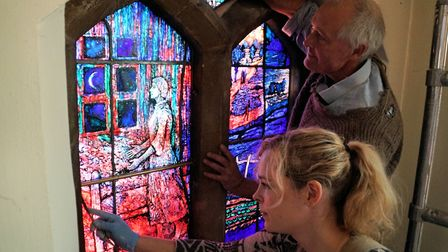 Thomas Denny and Elizabeth Hippisley-Cox working on the installation of the new windows at St Felix