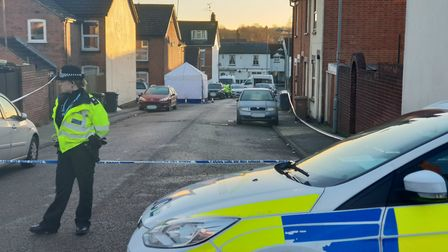 A policewoman guarding the scene in Kenyon Street Picture: ARCHANT